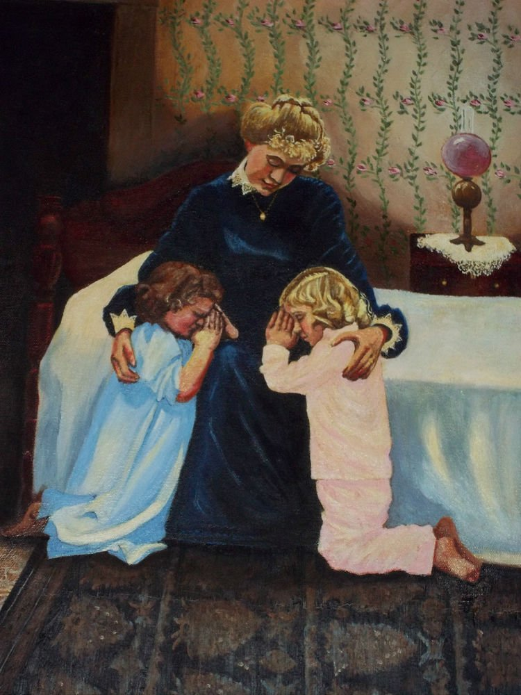 Mother Prays With Her Children